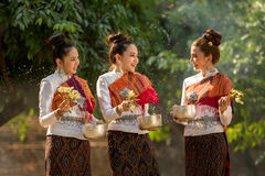 Thai girls splashing water during festival Songkran festival. Thai girls splashing water during festival Stock Images
