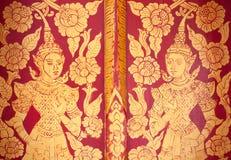 Thai gold lacquer gilt temple door. Detail Royalty Free Stock Photos