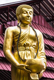 Thai gold monk statue Royalty Free Stock Photo