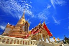 Thai gold pagoda against blue sky Stock Photos