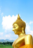 Thai Golden Buddhism Statue. With sky background Royalty Free Stock Image