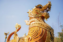 Thai golden lion statue style in the temple Royalty Free Stock Photo
