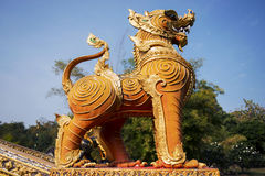 Thai golden lion statue style in the temple Stock Photography