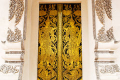 Thai golden painting door. Thai art golden painting temple door it's public object in public place available to publish Stock Photography