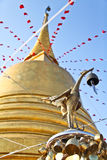 Thai golden swan in front of pagoda at golden mountain temple Royalty Free Stock Photos