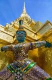 Thai Grand Palace. Thai demon on golden pagoda at the Grand Palace. Bangkok, Thailand stock image