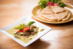 Thai green curry beef served with flatbread Royalty Free Stock Images