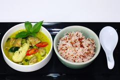Thai Green curry chicken served with brown rice. stock photos