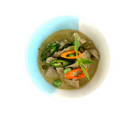Thai green curry pork in bowl with white Stock Photo