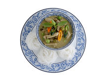 Thai green curry pork and rice noodles served on dish Royalty Free Stock Images