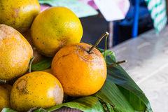 Thai green orange fruits on the banana leaf Royalty Free Stock Images