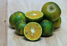 Thai green orange fruits on wood Royalty Free Stock Photos