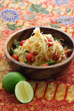 Thai green papaya salad. With string bean, cherry tomato and carrot, served in a wooden bowl Royalty Free Stock Photos