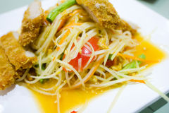Thai green papaya salad. With fried pork royalty free stock photos