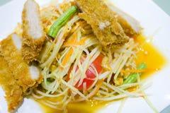 Thai green papaya salad. With fried pork Stock Images