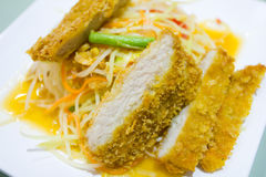 Thai green papaya salad. With fried pork Royalty Free Stock Image