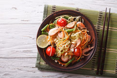 Thai green papaya salad with shrimp. horizontal top view. Thai green papaya salad with shrimp on a plate on the table. horizontal view from above royalty free stock image