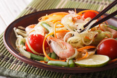 Thai green papaya salad som tam closeup. Horizontal. Thai green papaya salad som tam close-up on a plate. Horizontal royalty free stock photo
