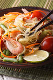 Thai green papaya salad som tam closeup. vertical Stock Photography