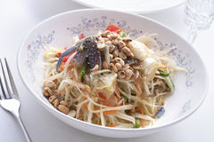 Thai green papaya salad. Som tam pu, a Thai green papaya salad with brined Crabs stock photos
