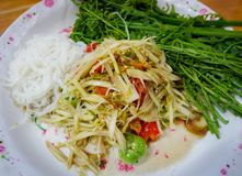Green papaya salad. Thai green papaya salad som tam or som tum royalty free stock photography
