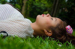 Thai Gril Sleep On Grassland relaxedly,Feel Free,Touch the World Stock Photo