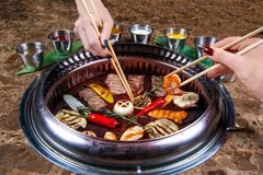 Thai grill on the table with various snacks stock image