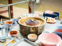 Thai grilled BBQ buffet pan. Burned Frying Pan, Thai grilled BBQ buffet. Close up of burned korean barbecue pan in thai style food. Pan is full of foods stains royalty free stock images