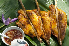Thai Grilled Chicken with Chili Sauce. Thai-style grilled chicken pieces with a bowl of sweet and spicy chili sauce royalty free stock photos