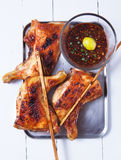Thai grilled chicken with spicy sauce on tray Royalty Free Stock Photo