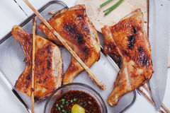 Thai grilled chicken with spicy sauce on tray Stock Images