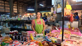 Thai grocer in food market. Woman. Stock Images