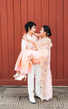 Thai Groom Carrying Cute Bride in Happiness Stock Photos
