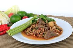 Thai ground pork salad, Spicy minced pork and pork liver salad. Thai ground pork salad, Spicy minced pork and pork liver salad (Larb Mu) on brown cloth Royalty Free Stock Photos