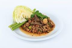 Thai ground pork salad, Spicy minced pork and pork liver salad. (Larb Mu). Thai ground pork salad, Spicy minced pork and pork liver salad (Larb Mu) on white Royalty Free Stock Photo