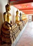 Thai guld- skulptur för Buddha Arkivbild