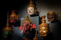 Thai handicraft mask head character khon. Thai handicraft mask head character from ramayana epic for thai khon art dancing collection set with dark background royalty free stock image