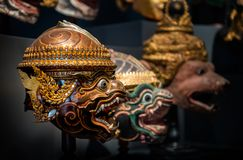Thai handicraft mask head character khon. Thai handicraft mask head character from ramayana epic for thai khon art dancing collection set with dark background stock photo