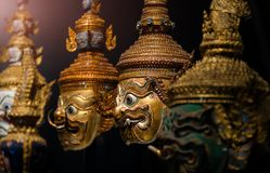 Thai handicraft mask head character khon. Thai handicraft mask head character from ramayana epic for thai khon art dancing collection set with dark background royalty free stock photography