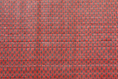 Thai handicraft red mat Stock Photos