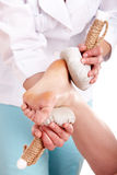 Thai herb compress massage of leg. Stock Photos