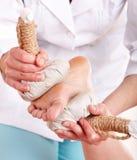 Thai Herb Compress Massage Of Leg. Royalty Free Stock Photo
