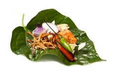Thai herb food. One bite of Thai herb food which including shallot coconut chili bean and dry shrimp stock photography