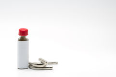 Thai herbal powder snuff in classic bottle with red cap and two snuff tube made of steel and chrome Stock Images