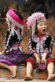 Thai Hill Tribe Children. Two young hill tribe children await visitors at the Wat Phra That Doi Suthep temple outside Chiang Mai, Thailand Stock Photography