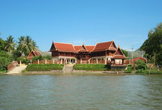 Thai Home at Riverside of River. Stock Photos