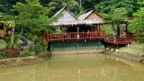 Thai house with a balcony over the pond. stock photos