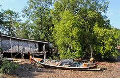 Thai house and a long tailed boat Stock Image
