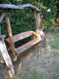 Thai house and the wooden swing seat in Thai style resort royalty free stock photo