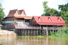 Thai house beside river in ayutthaya Royalty Free Stock Images